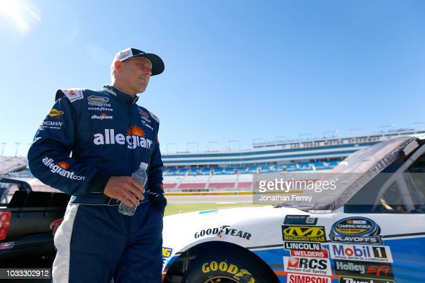Johnny Sauter driver of the Allegiant Chevrolet looks on during qualifying for the NASCAR Camping World Truck World of Westgate 200 at Las Vegas...