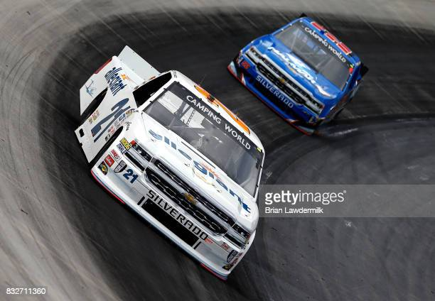 Johnny Sauter driver of the Allegiant Travel Chevrolet leads Stewart Friesen driver of the Halmar International Chevrolet during practice for the...