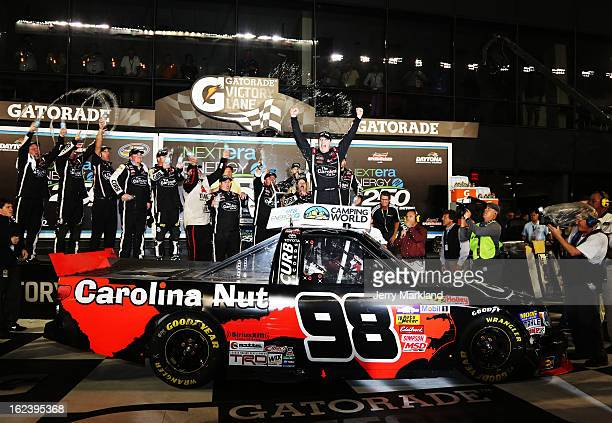 Johnny Sauter driver of the Carolina Nut Co/Curb Records Toyota celebrates in victory lane after winning the NASCAR Camping World Truck Series...