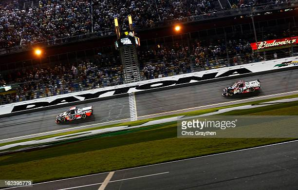 Johnny Sauter driver of the Carolina Nut Co/Curb Records Toyota crosses the finish to win the NASCAR Camping World Truck Series NextEra Energy...