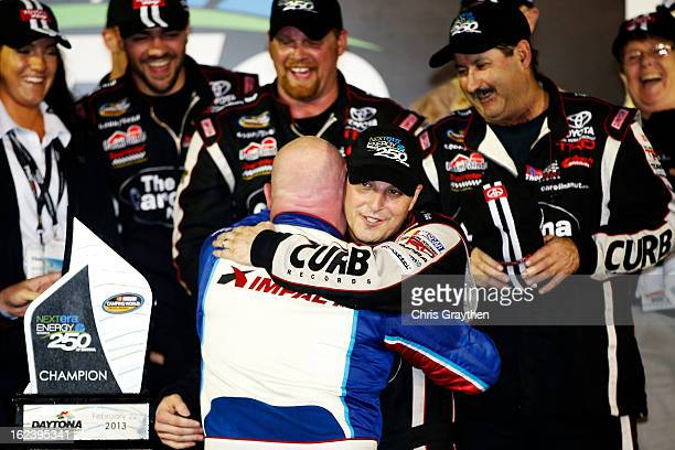 Johnny Sauter driver of the Carolina Nut Co/Curb Records Toyota celebrates with Todd Bodine driver of the Thorsport Racing Toyota after winning the...