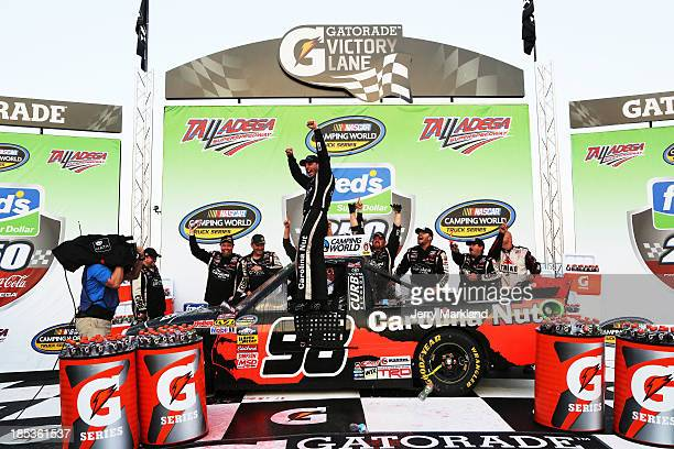 Johnny Sauter driver of the Carolina Nut / Curb Records Toyota celebrates in Victory Lane after winning the Camping World Truck Series Fred's 250...