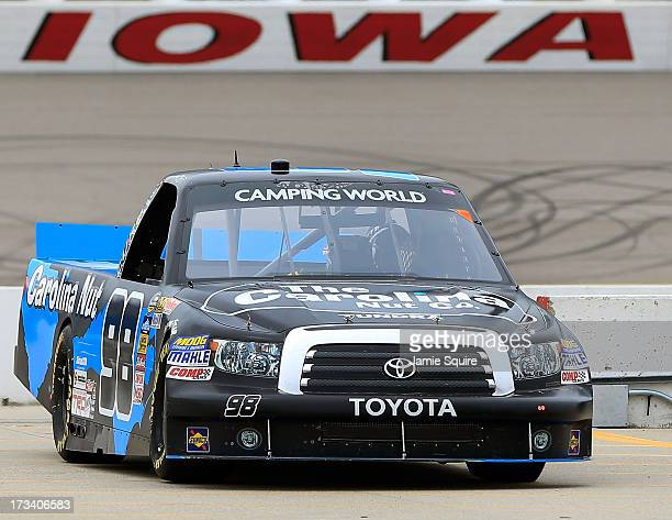 Johnny Sauter driver of the Carolina Nut/Curb Records Toyota practices ahead of the NASCAR Camping World Truck Series American Ethanol 200 at Iowa...