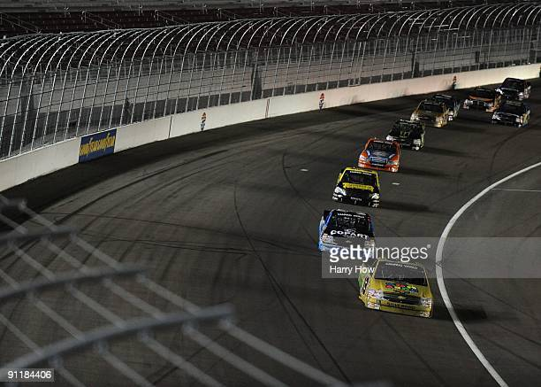 Johnny Sauter driver of the Fun Sand Chevrolet leads a line of trucks during the NASCAR Camping World Truck Series Las Vegas 350 at Las Vegas Motor...