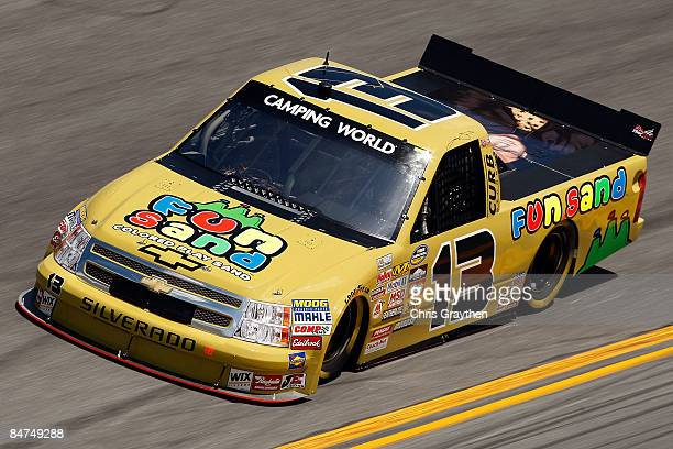 Johnny Sauter driver of the Fun Sand/Rodney Atkins/Curb Records Chevrolet drives during practice for the NASCAR Camping World Truck Series NextEra...
