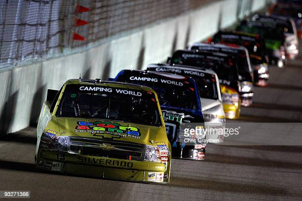 Johnny Sauter driver of the Fun Sand/Rodney Atkins/Curb Records Chevrolet leads a group of trucks during the NASCAR Camping World Truck Series Ford...