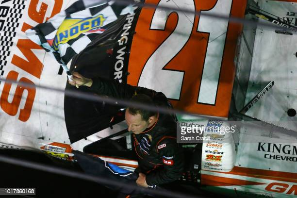 Johnny Sauter driver of the GMS Fabrication Chevrolet celebrates after winning the NASCAR Camping World Truck Series UHOH 200 at Bristol Motor...