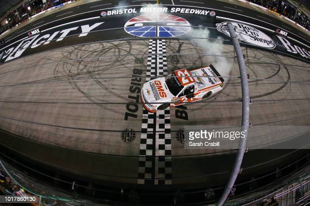 Johnny Sauter driver of the GMS Fabrication Chevrolet celebrates with a burnout after winning the during the NASCAR Camping World Truck Series UHOH...