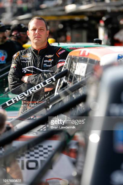 Johnny Sauter driver of the GMS Fabrication Chevrolet stands in the garage area during practice for the NASCAR Camping World Truck Series UHOH 200 at...