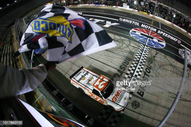 Johnny Sauter driver of the GMS Fabrication Chevrolet takes the checkered flag to win the during the NASCAR Camping World Truck Series UHOH 200 at...