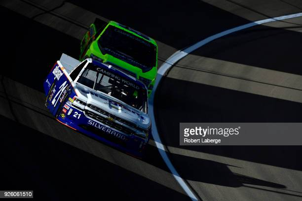 Johnny Sauter driver of the GMS Racing Allegiant Airlines Chevrolet leads Matt Crafton driver of the ThorSport Racing Hormel Black Label...