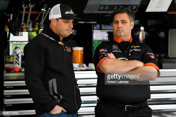 Johnny Sauter driver of the GMS Racing Allegiant Airlines Chevrolet talks to a crew member during practice for the NASCAR Camping World Truck Series...