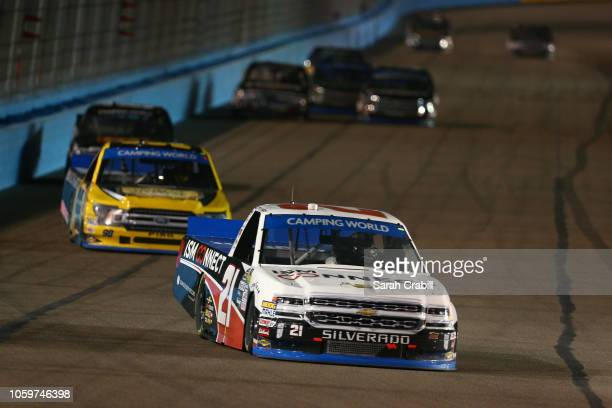 Johnny Sauter driver of the ISM Connect Chevrolet and Grant Enfinger driver of the Protect The Harvest/Curb Records Ford lead a pack of trucks during...