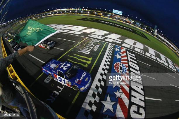 Johnny Sauter driver of the ISM Connect Chevrolet and Noah Gragson driver of the Safelite AutoGlass Toyota lead the field to green for the start of...