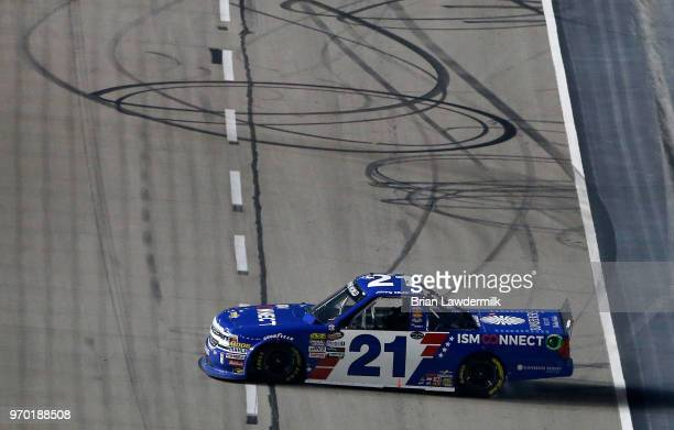 Johnny Sauter driver of the ISM Connect Chevrolet celebrates after winning the NASCAR Camping World Truck Series PPG 400 at Texas Motor Speedway on...