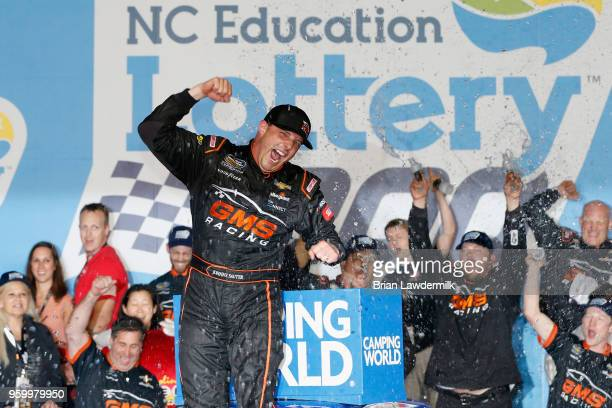 Johnny Sauter driver of the ISM Connect Chevrolet celebrates in Victory Lane after winning the NASCAR Camping World Truck Series North Carolina...