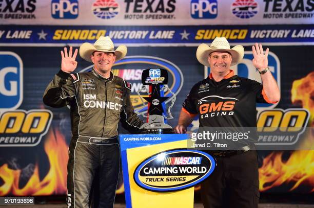 Johnny Sauter driver of the ISM Connect Chevrolet celebrates in Victory Lane after winning the NASCAR Camping World Truck Series PPG 400 at Texas...