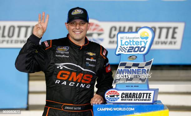 Johnny Sauter driver of the ISM Connect Chevrolet celebrates with the trophy in Victory Lane after winning the NASCAR Camping World Truck Series...