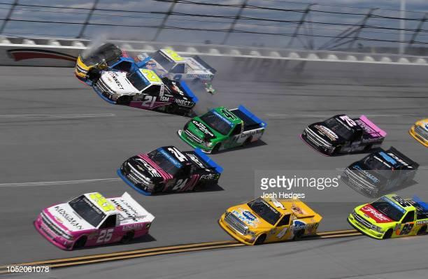 Johnny Sauter driver of the ISM Connect Chevrolet Chris Fontaine driver of the Glenden Enterprises Chevrolet and Spencer Gallagher driver of the...