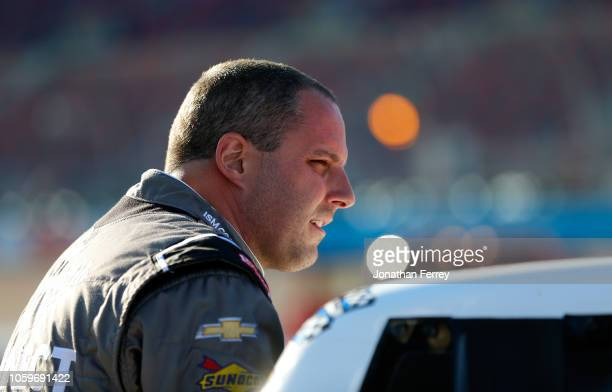 Johnny Sauter driver of the ISM Connect Chevrolet climbs into his truck during qualifying for the NASCAR Camping World Truck Series Lucas Oil 150 at...