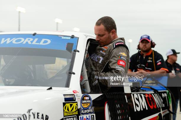 Johnny Sauter driver of the ISM Connect Chevrolet climbs into his truck during qualifying for the NASCAR Camping World Truck Series Ford EcoBoost 200...