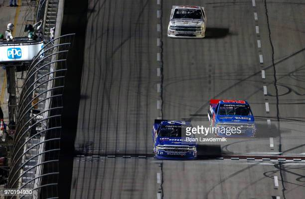Johnny Sauter driver of the ISM Connect Chevrolet crosses the finish line ahead of Stewart Friesen of Canada driver of the We Build America Chevrolet...