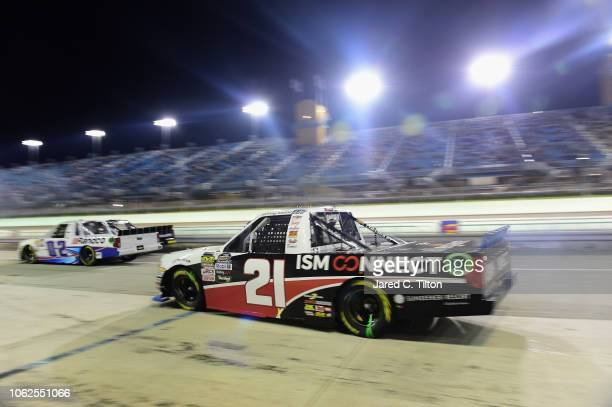 Johnny Sauter driver of the ISM Connect Chevrolet drives on pit road during the NASCAR Camping World Truck Series Ford EcoBoost 200 at HomesteadMiami...