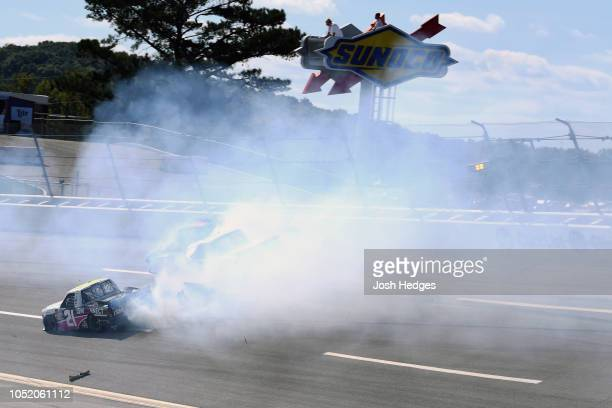Johnny Sauter driver of the ISM Connect Chevrolet is involved in an ontrack incident during the NASCAR Camping World Truck Series Fr8Auctions 250 at...