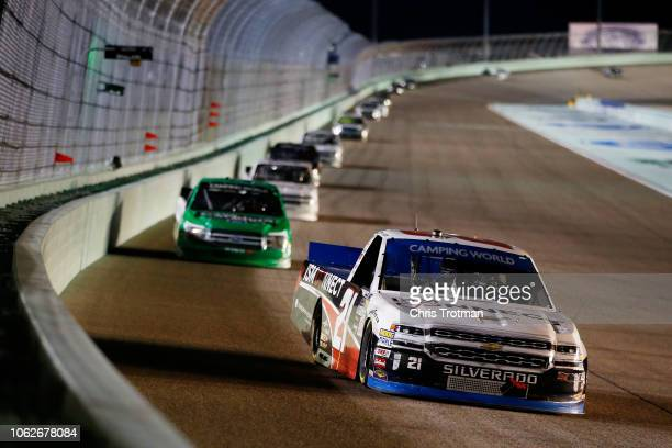 Johnny Sauter driver of the ISM Connect Chevrolet leads a pack of trucks during the NASCAR Camping World Truck Series Ford EcoBoost 200 at...