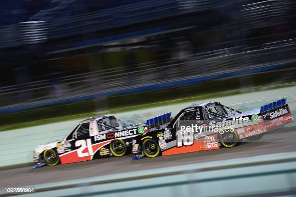 Johnny Sauter driver of the ISM Connect Chevrolet leads Noah Gragson driver of the Safelite AutoGlass Toyota during the NASCAR Camping World Truck...