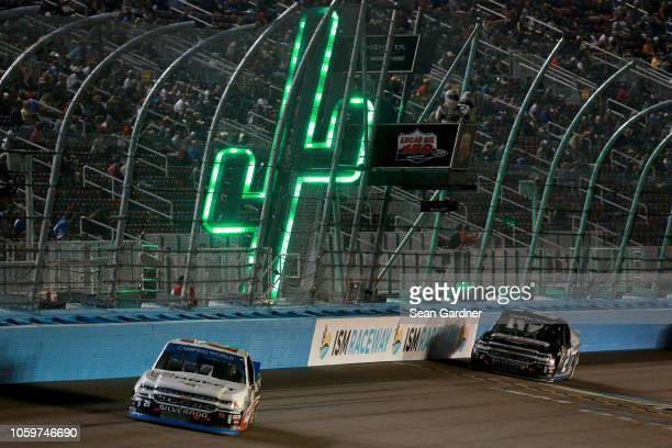 Johnny Sauter driver of the ISM Connect Chevrolet leads Sheldon Creed driver of the AM Ortega/United Rentals Chevrolet during the NASCAR Camping...