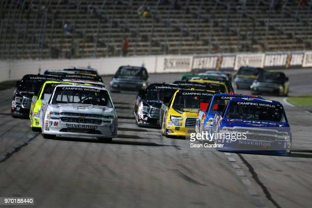 Johnny Sauter driver of the ISM Connect Chevrolet leads the field during the NASCAR Camping World Truck Series PPG 400 at Texas Motor Speedway on...