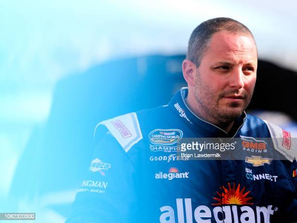 Johnny Sauter driver of the ISM Connect Chevrolet looks on during practice for the NASCAR Camping World Truck Series Ford EcoBoost 200 at...