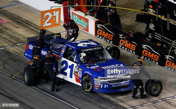 Johnny Sauter driver of the ISM Connect Chevrolet makes a pit stop during the NASCAR Camping World Truck Series PPG 400 at Texas Motor Speedway on...