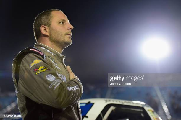 Johnny Sauter driver of the ISM Connect Chevrolet participates in prerace ceremonies for the NASCAR Camping World Truck Series Ford EcoBoost 200 at...