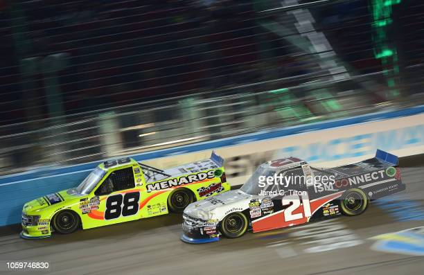 Johnny Sauter driver of the ISM Connect Chevrolet races Matt Crafton driver of the Ideal Door/Menards Ford during the NASCAR Camping World Truck...