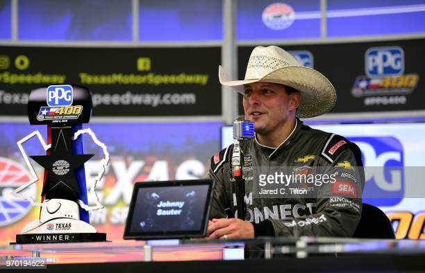 Johnny Sauter driver of the ISM Connect Chevrolet speaks with the media during a press conference after winning the NASCAR Camping World Truck Series...