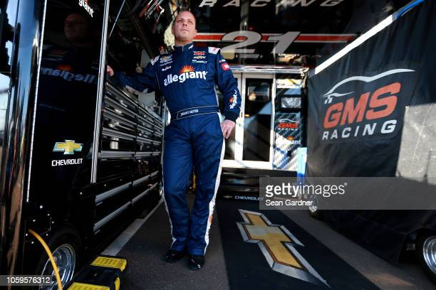 Johnny Sauter driver of the ISM Connect Chevrolet stands in the garage area during practice for the NASCAR Camping World Truck Series Lucas Oil 150...