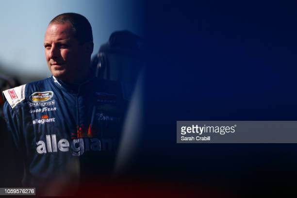 Johnny Sauter driver of the ISM Connect Chevrolet stands next to his truck during practice for the NASCAR Camping World Truck Series Lucas Oil 150 at...