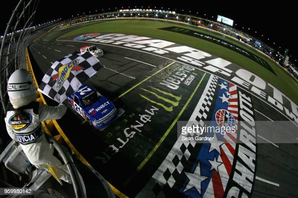 Johnny Sauter driver of the ISM Connect Chevrolet takes the checkered flag to win the NASCAR Camping World Truck Series North Carolina Education...