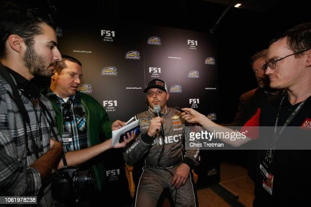 Johnny Sauter driver of the ISM Connect Chevrolet talks to the media during media day for the NASCAR Camping Truck Series Championship at Miami Beach...