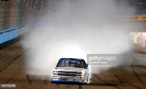 Johnny Sauter driver of the ISMConnect Chevrolet doe a burnout after winning the NASCAR Camping World Truck Series Lucas Oil 150 at Phoenix...
