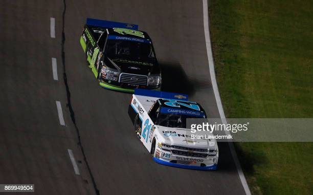 Johnny Sauter driver of the ISMConnect Chevrolet leads Austin Cindric driver of the Fitzgerald Glider Kits Ford during the NASCAR Camping World Truck...