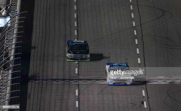 Johnny Sauter driver of the ISMConnect Chevrolet takes the checkered flag ahead of Austin Cindric driver of the Fitzgerald Glider Kits Ford to win...