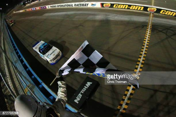 Johnny Sauter driver of the ISMConnect Chevrolet takes the checkered flag to win the NASCAR Camping World Truck Series Lucas Oil 150 at Phoenix...