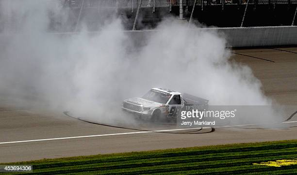 Johnny Sauter driver of the Nextant/Curb Toyota celebrates with a burnout after winning the NASCAR Camping World Truck Series Careers For Veterans...
