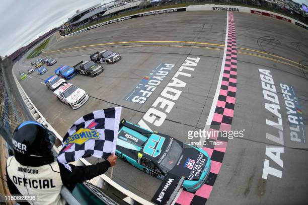Johnny Sauter driver of the Tenda Heal Ford crosses the finish line first during the NASCAR Gander Outdoor Truck Series Sugarlands Shine 250 at...