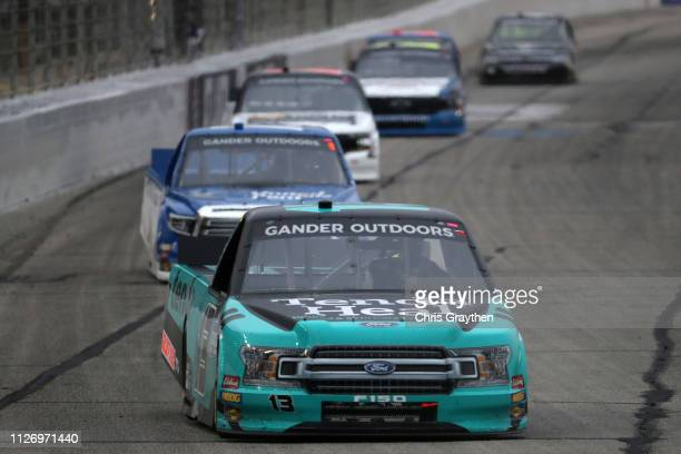 Johnny Sauter driver of the Tenda Heal Ford leads a pack of cars during the NASCAR Gander Outdoors Truck Series Ultimate Tailgating 200 at Atlanta...