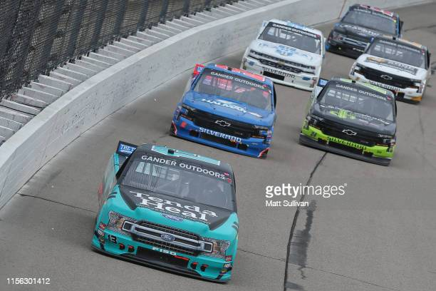 Johnny Sauter driver of the Tenda Products Ford leads a pack of trucks during the NASCAR Gander Outdoor Truck Series MM's 200 Presented by Casey's...