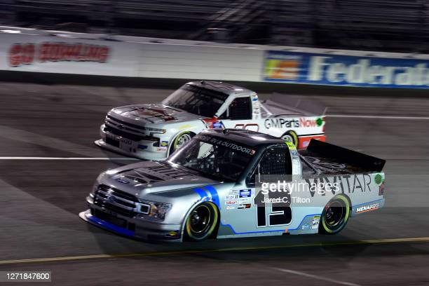 Johnny Sauter, driver of the Vivitar Ford, and Carson Hocevar, driver of the Scott's Chevrolet, race during the NASCAR Gander Outdoors Truck Series...